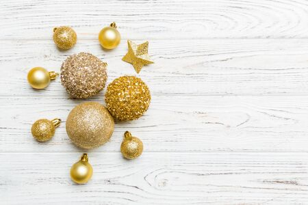 Creative set of New Year baubles and decorations on wooden background. Top view of Christmas time concept. Copy space. 스톡 콘텐츠