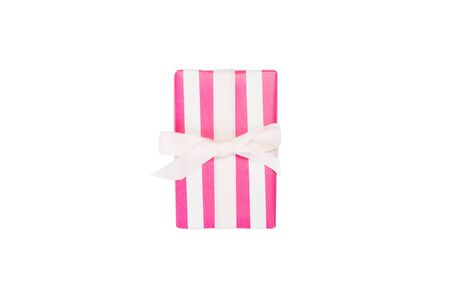 Christmas or other holiday handmade present in pink paper with white ribbon. Isolated on white background, top view. thanksgiving Gift box concept.