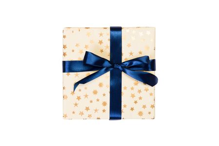 Christmas or other holiday handmade present in gold paper with blue ribbon. Isolated on white background, top view. thanksgiving Gift box concept. 스톡 콘텐츠