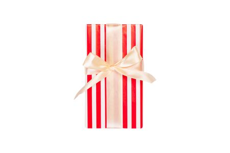 Christmas or other holiday handmade present in red paper with gold ribbon. Isolated on white background, top view. thanksgiving Gift box concept. 스톡 콘텐츠