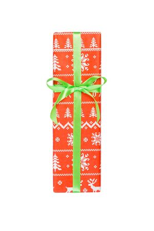 Christmas or other holiday handmade present in red paper with green ribbon. Isolated on white background, top view. thanksgiving Gift box concept.