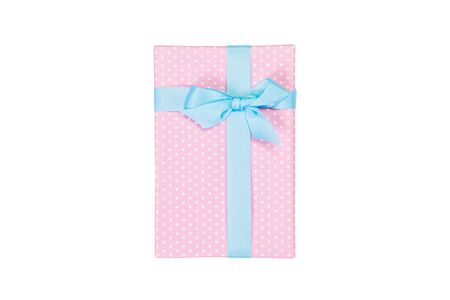 Christmas or other holiday handmade present in pink paper with blue ribbon. Isolated on white background, top view. thanksgiving Gift box concept. 스톡 콘텐츠