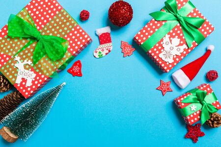 Top view of Christmas decorations on blue background. New Year holiday concept with copy space.