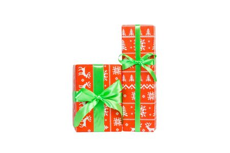 Set of Christmas or other holiday handmade present in red paper with green ribbon. Isolated on white background, top view. thanksgiving Gift box concept.