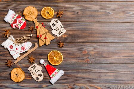 Top view of Christmas decorations and toys on wooden background. Copy space. Empty place for your design. New Year concept. Stock Photo