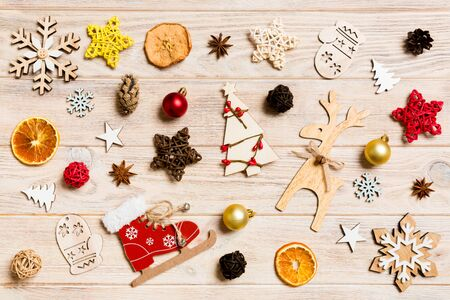 Top view of Christmas toys on wooden background. New Year ornament. Holiday concept. Stock Photo