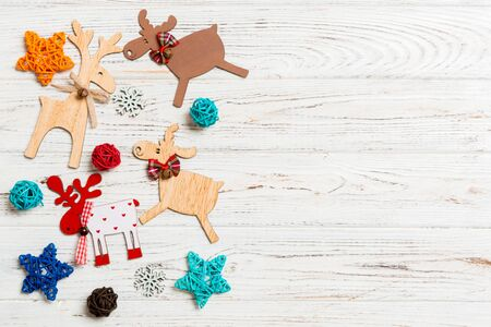 Top view of Christmas decorations and toys on wooden background. Copy space. Empty place for your design. New Year concept. Stock Photo - 133655485