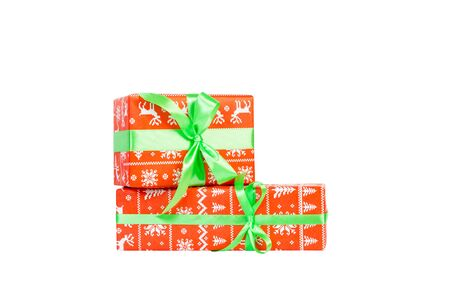Group of Christmas or other holiday handmade present in red paper with green ribbon. Isolated on white background, top view. thanksgiving Gift box concept.
