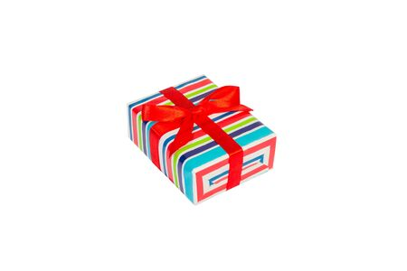 Christmas or other holiday handmade present in colored paper with red ribbon. Isolated on white background, top view. thanksgiving Gift box concept. Stok Fotoğraf