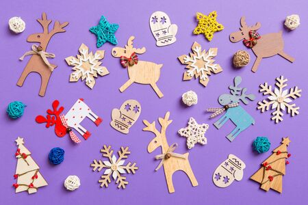 Festive decorations and toys on purple background. Merry Christmas concept.