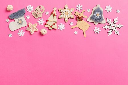Top view of holiday decorations and toys on pink background. Christmas ornament concept with empty space for your design. Фото со стока