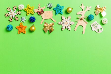Top view of green background with New Year toys and decorations. Christmas time concept with copy space. Stock Photo