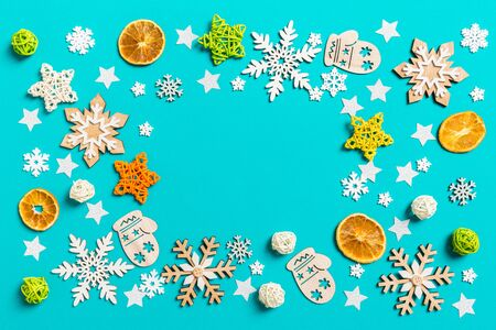 Top view of blue background with New Year toys and decorations. Christmas time concept with copy space. Stock Photo