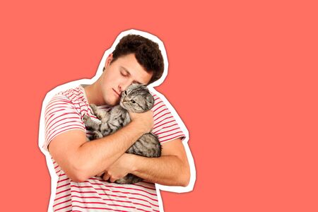 a guy holding a British cat in his arms and hugging her. emotional man isolated Magazine collage style with trendy color.