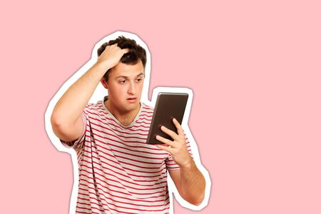 thinking guy looks at the tablet and scratches his head with his hand. emotional guy isolated on white background Magazine collage style with trendy color.