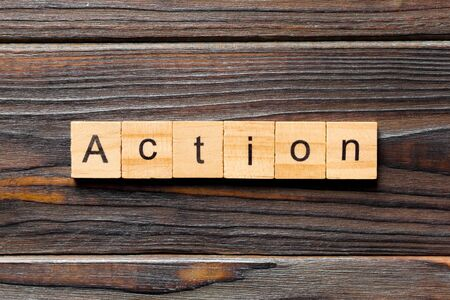 Action word written on wood block. Action text on table, concept. Stok Fotoğraf