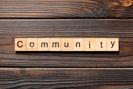 Community word written on wood block. Community text on wooden table for your desing, Top view concept. Stok Fotoğraf