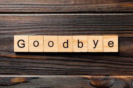 Goodbye word written on wood block. Goodbye text on table, concept. Stok Fotoğraf
