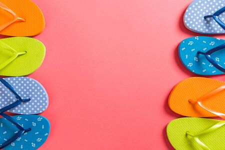 a lot of flip flop colored sandals, summer vacation on colored background, copy space top view.