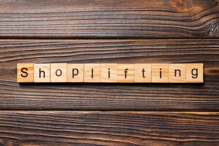 Shoplifting word written on wood block. Shoplifting text on wooden table for your desing, Top view concept. Stok Fotoğraf