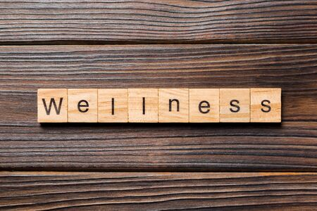 Wellness word written on wood block. Wellness text on wooden table for your desing, concept. Stok Fotoğraf