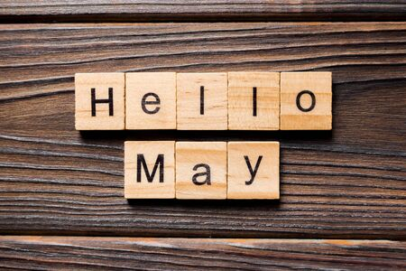 Hello May word written on wood block. Hello May text on table, concept. Stok Fotoğraf