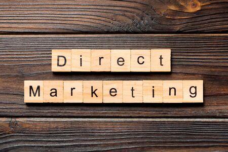 Direct marketing word written on wood block. Direct marketing text on wooden table for your desing, concept. Stok Fotoğraf