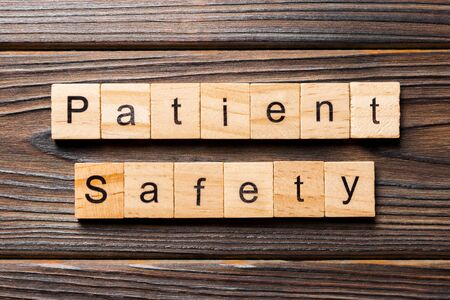 Patient Safety word written on wood block. Patient Safety text on wooden table for your desing, concept.