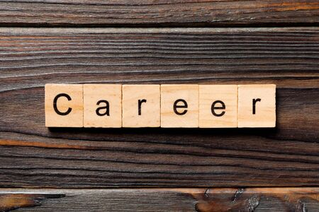Career word written on wood block. Career text on wooden table for your desing, Top view concept.