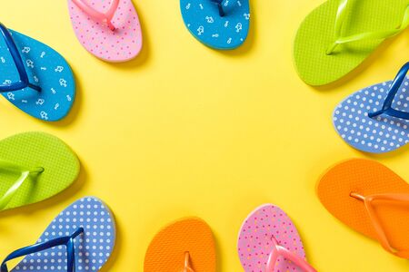 a lot of flip flop colored sandals, summer vacation on colored background, copy space top view. Фото со стока - 140964522
