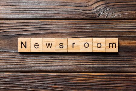 News room word written on wood block. News room text on wooden table for your desing, concept.