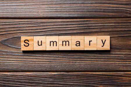 Summary word written on wood block. Summary text on table, concept.
