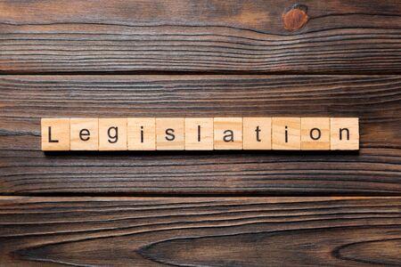 legislation word written on wood block. legislation text on table, concept.
