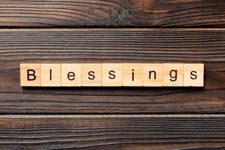 Blessings word written on wood block. Blessings text on wooden table for your desing, Top view concept.