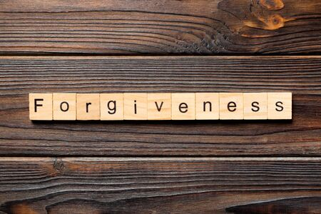 forgiveness word written on wood block. forgiveness text on table, concept. Stock Photo