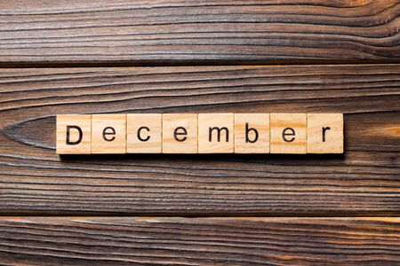 December word written on wood block. December text on wooden table for your desing, Top view concept. Standard-Bild - 142113271