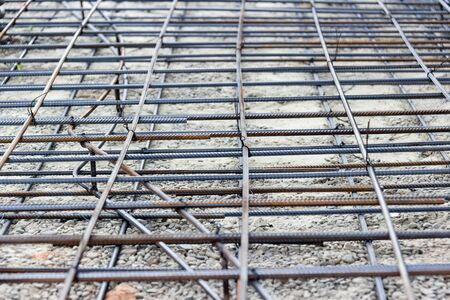 Background of reinforcing steel bars for building armature. Steel reinforcement in the construction of the building.