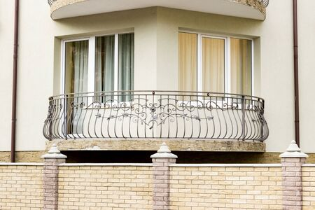 Beautiful small corner balcony on a modern building apartment.