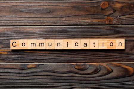 COMMUNICATION word written on wood block. COMMUNICATION text on wooden table for your design, concept. Foto de archivo