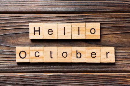 Hello October word written on wood block. Hello October text on table, concept.