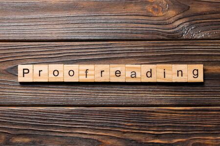 proofreading word written on wood block. proofreading text on table, concept. Stockfoto