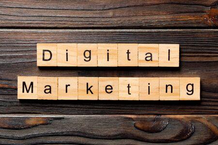 Digital Marketing word written on wood block. Digital Marketing text on wooden table for your desing, concept.
