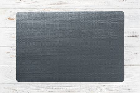 Top view of empty black table napkin for dinner on wooden background with copy space. Archivio Fotografico - 142776871