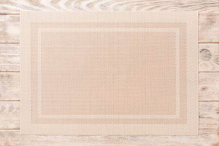 Top view of brown tablecloth for food on wooden background. Empty space for your design. Archivio Fotografico - 142861496