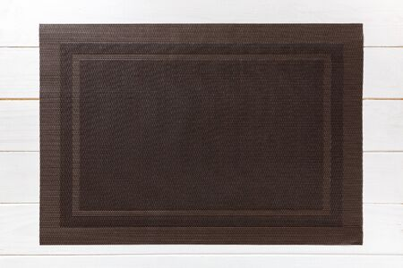 Top view of empty brown table napkin for dinner on wooden background with copy space. Archivio Fotografico - 143030817