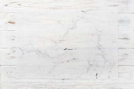 Top view of textile white mat for dinner on wooden background with copy space.
