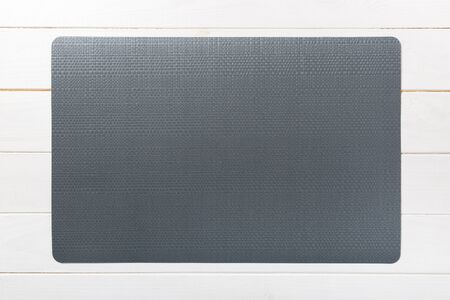 Top view of empty black table napkin for dinner on wooden background with copy space.
