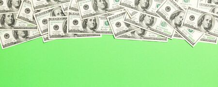 dollar bills a on a light colored background. copy space, top view business concept. 스톡 콘텐츠