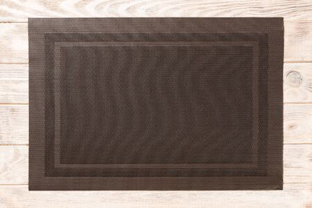 Top view of empty brown tablecloth on wooden background with copy space. Archivio Fotografico