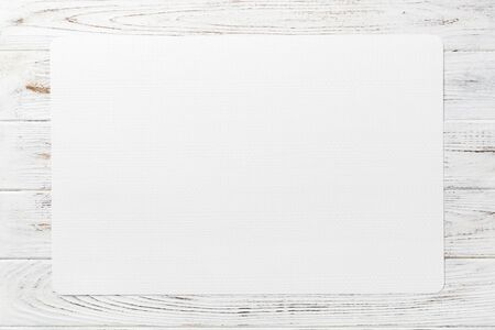 Top view of white table napkin on wooden background. Place mat with empty space for your design. Archivio Fotografico